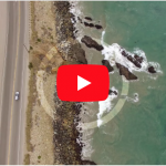 Roadside Ocean Waves Overhead | Drone Stock Footage